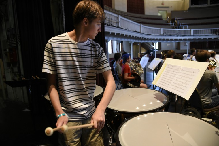 Christian Hartman, 13 of Manchester, plays timpani (or kettle drums) during rehearsal on the campus of McDaniel College.  (Barbara Haddock Taylor/Baltimore Sun)