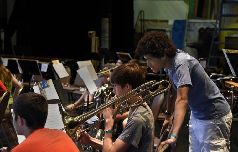 Richard Matties, 17 of Ellicott City, plays his trombone as Jordan Moore, 18 of Baltimore, listens during rehearsal. (Barbara Haddock Taylor/Baltimore Sun)