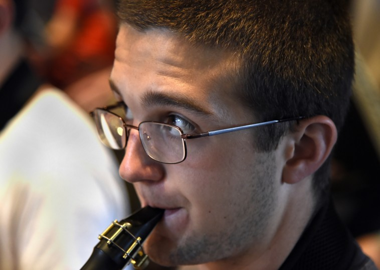 William Mann, 15 of Easton, plays the alto saxophone at the 30th annual summer music camp at McDaniel College.  (Barbara Haddock Taylor/Baltimore Sun)