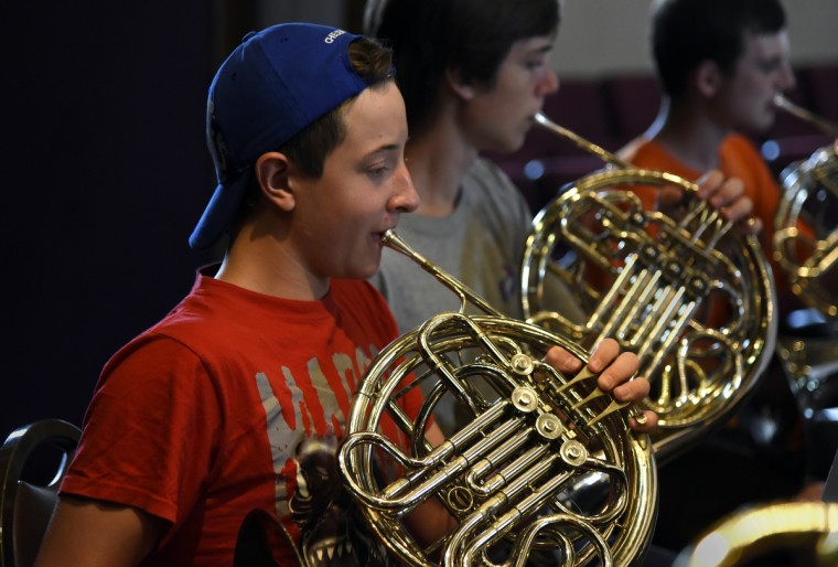 Graham Lovely, 14 of Hyattsville, plays French Horn during rehearsal at summer music camp on the campus of McDaniel College. (Barbara Haddock Taylor/Baltimore Sun)