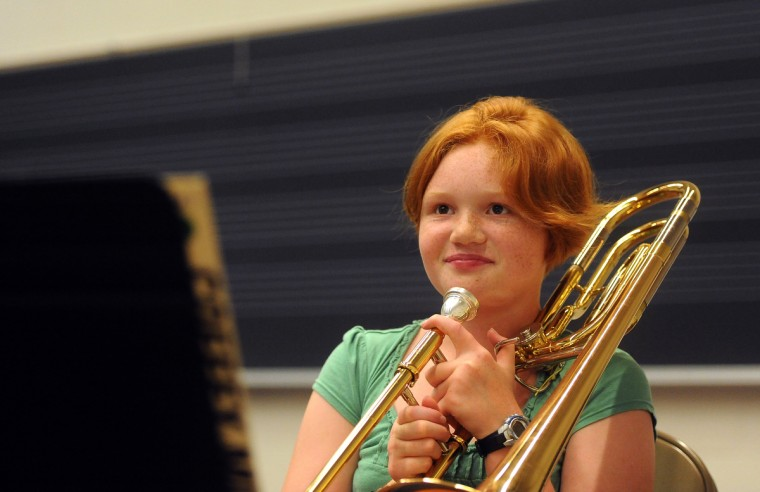 Ellie Meeks, 13 of Columbia, practices trombone during a rehearsal at the 30th annual summer music camp at McDaniel College. (Barbara Haddock Taylor/Baltimore Sun)