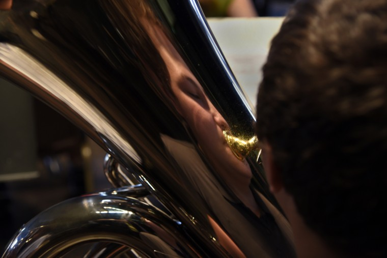 Zach Harman, 16 of Spring Grove PA, is reflected in his tuba during rehearsal. (Barbara Haddock Taylor/Baltimore Sun)