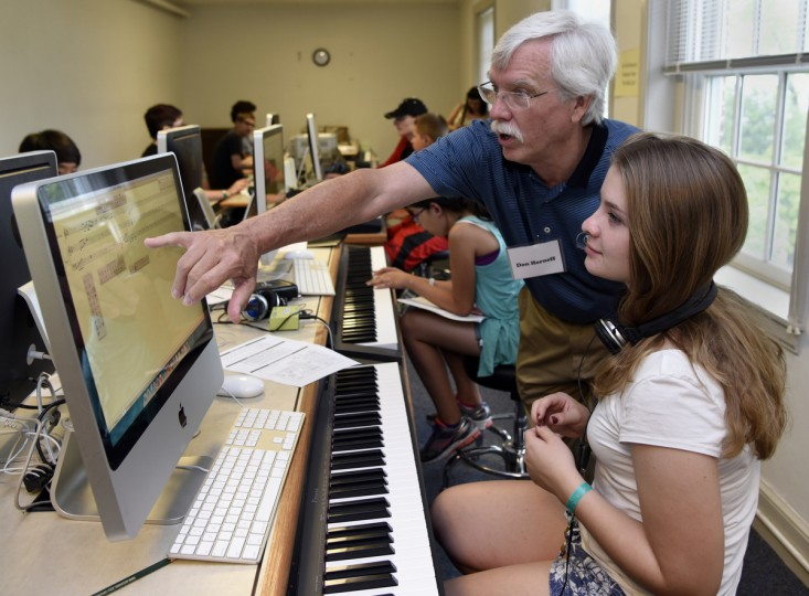"Don Horneff, an adjunct professor at McDaniel College, works with Elisabeth Plescia, 15 of Sykesville,  on the ""Finale"" composition program in the music instrumental digital interface (MIDI) lab at the 30th annual summer music camp for middle and high school students on the campus of McDaniel College.  (Barbara Haddock Taylor/Baltimore Sun)"