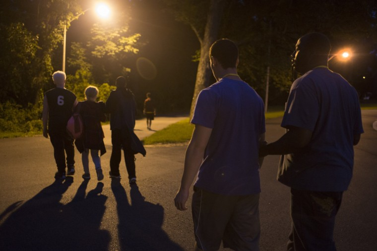Attendees walk across campus to attend a bonfire at Camp Abilities, hosted by the Maryland School for the Blind. (Tom Brenner/ Baltimore Sun)