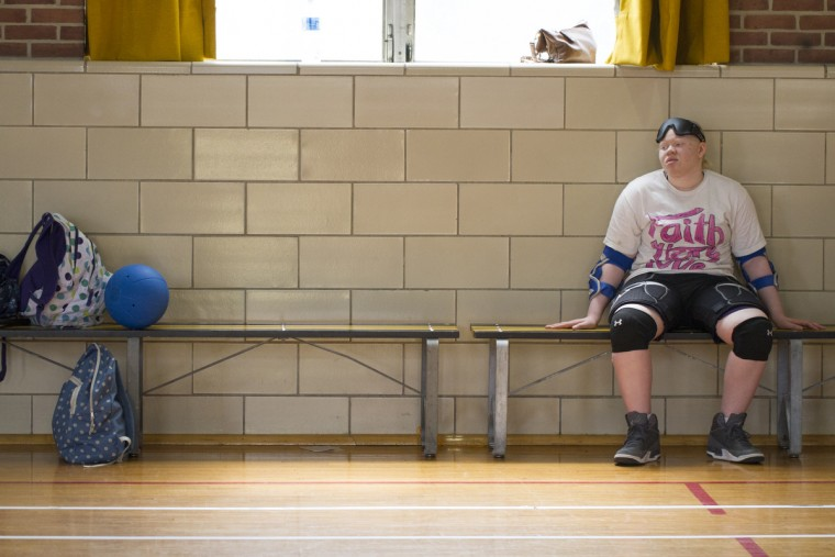 Tori Rice, 15, takes a break from playing Goalball.  Goalball is a Paralympic sport designed for the visually impaired.  Bells inside the balls help orient the players, indicating the direction of the on-coming ball.   (Tom Brenner/ Baltimore Sun)