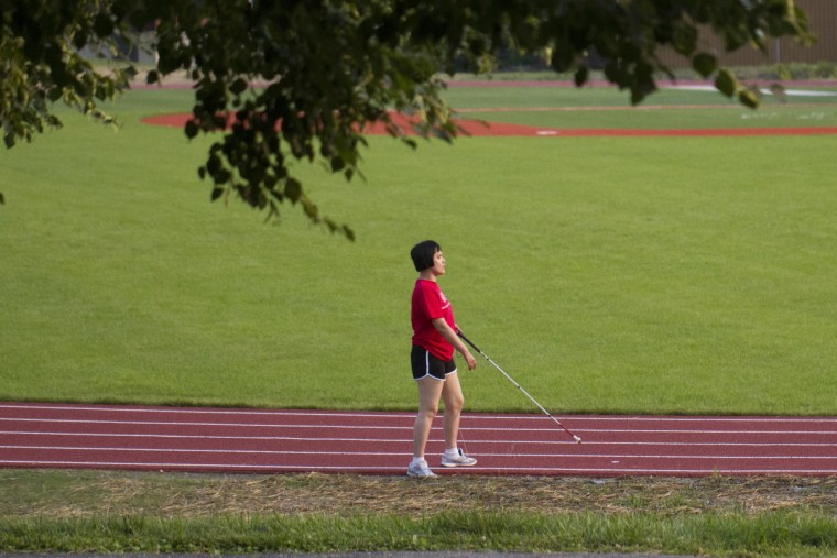 Lisa Lin walks the track at the Maryland School for the Blind.  (Tom Brenner/ Baltimore Sun)