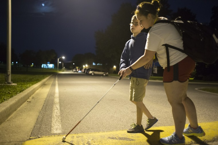 Amaurie Davidson, 13,left, is taught how to navigate in the street by instructor Marleen Mangre, right.  She explains that following the speed bump will take you away from the dangers of passing cars.  (Tom Brenner/ Baltimore Sun)