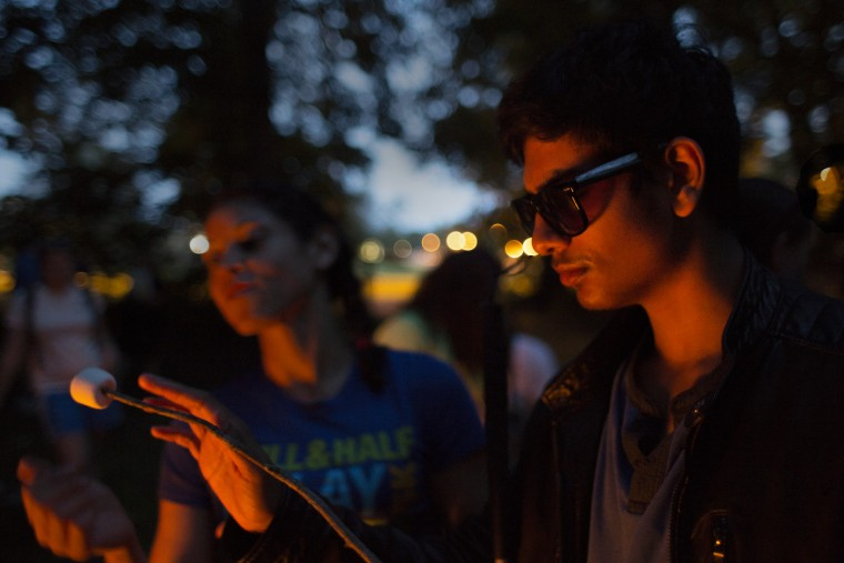 Shawn Abraham, 15, feels his  marshmallow after holding it over the campfire before making a s'more.  Each night, Camp Abilities attendees attend a camp fire, marking the end of each day.  (Tom Brenner/ Baltimore Sun)
