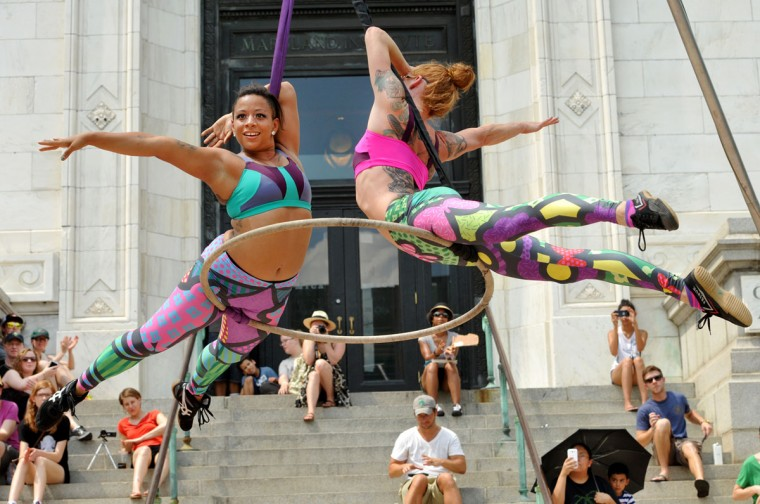 """Aerial dancers Nina Charity, left, and Kelly Jo Stoull, right, perform """"Pop-Art in Action"""" at Artscape. (Amy Davis/Baltimore Sun)"""