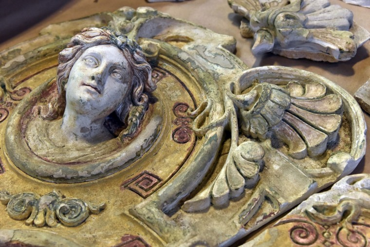 A polychrome ceiling medallion in antique plaster sits in the warehouse at Second Chance, Inc., which is a nonprofit corporation that sells reclaimed building materials. (Kim Hairston/Baltimore Sun)