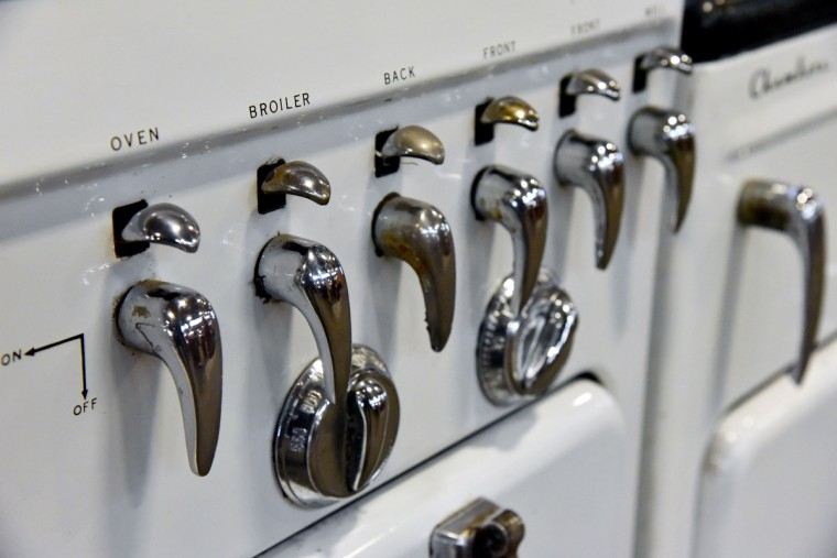 A vintage Chamber stove sports chrome handles and knobs of various shapes.  (Kim Hairston/Baltimore Sun)