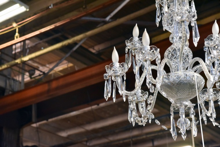 A Waterford 9-arm crystal chandelier hangs from the rafters at Second Chance, Inc. (Kim Hairston/Baltimore Sun)