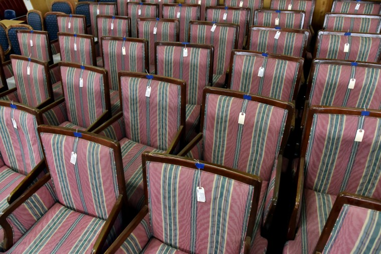 A large selection of pink stripped skirted chairs are on display in a 200,000 sq. ft. warehouse. Items like these are put up for sale instead of being discarded and placed in a landfill. Outside the building there are items for free like mattresses, windows, and furniture. (Kim Hairston/Baltimore Sun)