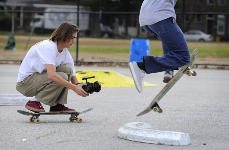Josh Ferguson,18, of Baltimore, uses a video camera to record a friend while skateboarding at the Skatepark of Baltimore in Hampden. (Lloyd Fox/Baltimore Sun)