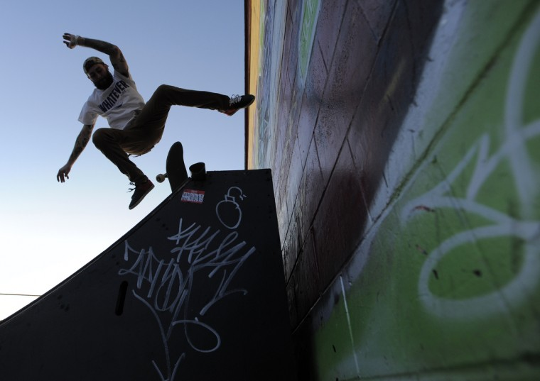 Matt Price of Baltimore flies off of his skateboard after trying to skate up a wall. (Lloyd Fox/Baltimore Sun)