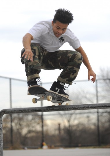 Kim Scott of Pikesville leaps over a grind rail at the Skatepark of Baltimore in Hampden. (Lloyd Fox/Baltimore Sun)