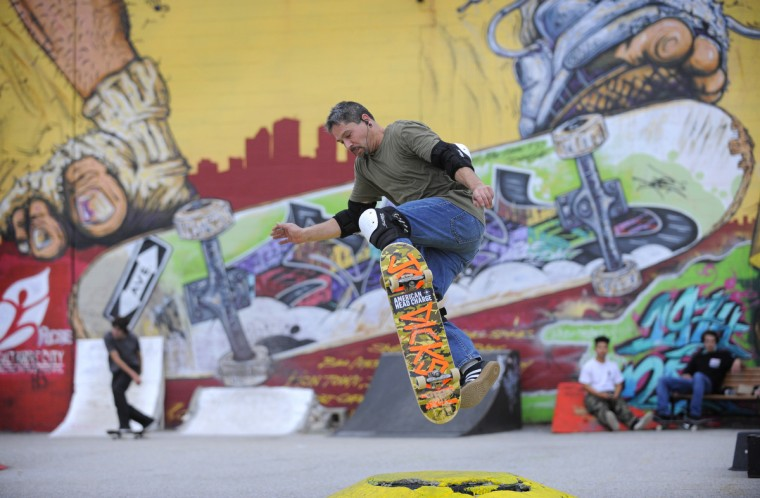 "Dave Allison of Middle River performs an ""Ollie"" at the Skatepark of Baltimore in Hampden. (Lloyd Fox/Baltimore Sun)"