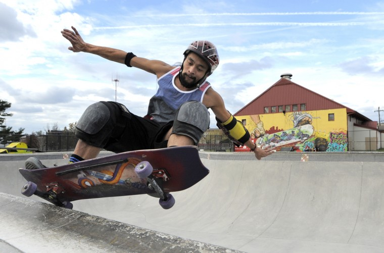 Nino Almazon, 30, struggles to maintain his balance as he slides along the lip of the bowl at Skatepark of Baltimore in Hampden. (Lloyd Fox/Baltimore Sun)