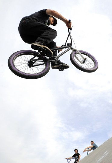Adam Maske of Hampden does tricks on his bike around the bowl at the Skatepark of Baltimore.  (Lloyd Fox/Baltimore Sun)