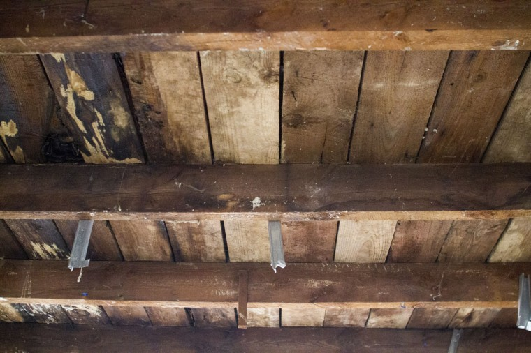 Details from a vacant rowhome in the 900 block of N. Port Street. Many of the homes have sat vacant for decades after being lived in for a hundred years. Three of the ten homes in the block were collapsed inside. (Kalani Gordon, Baltimore Sun)