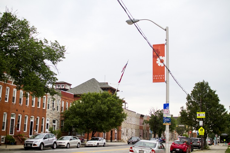 A banner showcasing the neighborhood as 'Locust Point' overlooks Fort Avenue. (Kalani Gordon, Baltimore Sun, June 2015)