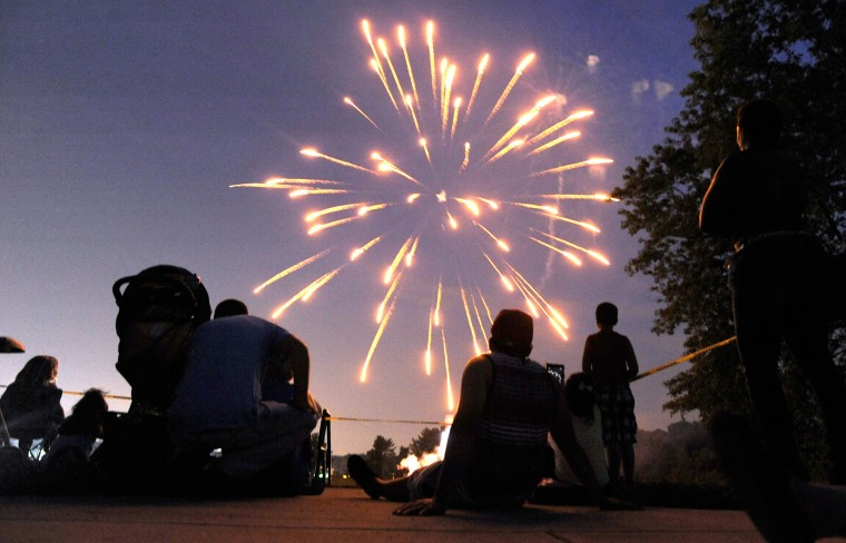 Fireworks in Towson, July 5. Photo taken with Nikon D700. The f-stop was set at f/2.8, the ISO at 3200 and the focal length at 17mm. The exposure time was 1/4th of a second. (Steve Ruark/For The Baltimore Sun)