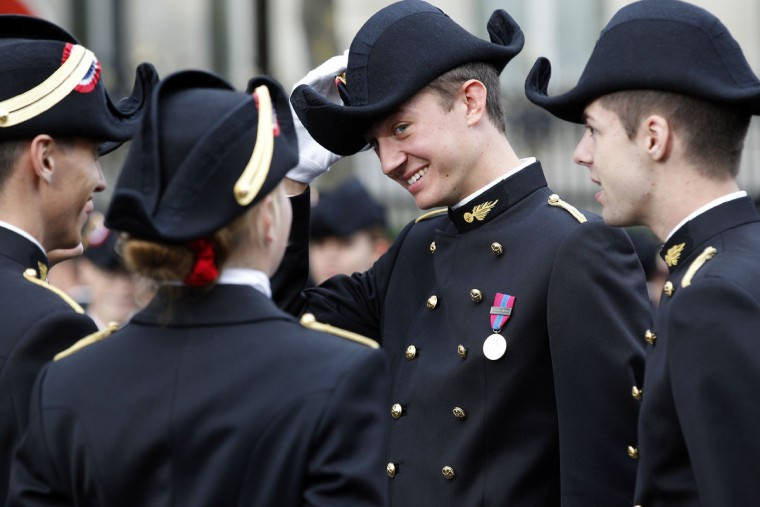 Frederic Arnault (center), son of French luxury group LVMH Chairman and CEO Bernard Arnault, and student of the Ecole Polytechnique (Special military school of Polytechnique), attends the preparation of the annual Bastille Day military parade on July 14, 2015 in Paris, France. The Bastille Day, the French National Day, is held annually on 14 July to commemorate the storming of the Bastille fortress in 1789. (Photo by Thierry Chesnot/Getty Images)