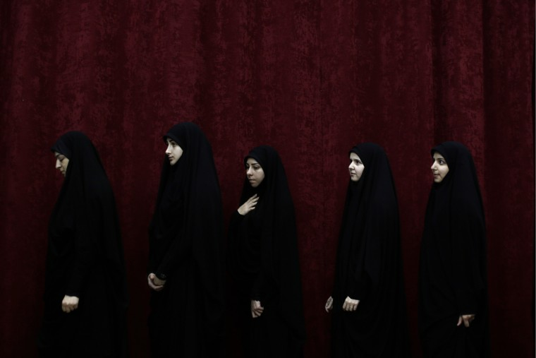 Lebanese Shiite women line up to receive their certificates before a speech by Hezbollah leader Hassan Nasrallah during their graduation ceremony, in the southern suburb of Beirut, Lebanon, Saturday, July 25, 2015. Nasrallah said he is proud of U.S. sanctions targeting three members of the group. The U.S. Treasury Department slapped sanctions last week on three Hezbollah members including senior figure Mustafa Badr al Din, and a Lebanese businessman for their suspected militant activities in support of Syrian President Bashar Assad. (Associated Press/Hassan Ammar)
