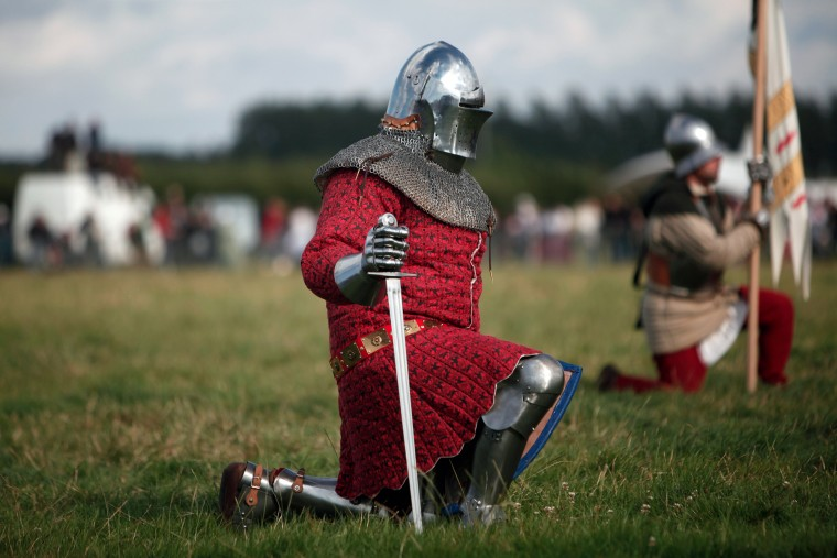 A man wearing an armor attends a reenactment of the Battle of Agincourt, in Agincourt, northern France, Saturday, July 25, 2015. The French are hosting a reenactment of the clash with England this weekend. More than 800 people in Medieval garb are gathering at the site to commemorate the battle, which was a turning point in the Hundred Years' War.. (Associated Press/Thibault Camus)
