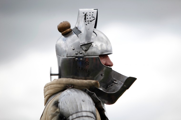 A man wears a armor as he attends a reenactment of the Battle of Agincourt, in Agincourt, northern France, Saturday, July 25, 2015. The French are hosting a reenactment of the clash with England this weekend. More than 800 people in Medieval garb are gathering at the site to commemorate the battle, which was a turning point in the Hundred Years' War. (Associated Press/Thibault Camus)