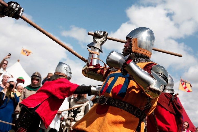 People fight during the reenactment of a tournament of knights fight, in Agincourt, northern France, Saturday, July 25, 2015. The French are hosting a reenactment of the clash with England this weekend. More than 800 people in Medieval garb are gathering at the site to commemorate the battle, which was a turning point in the Hundred Years' War. (Associated Press/Thibault Camus)
