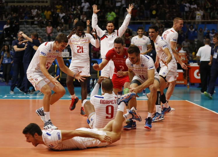 France's players celebrate their victory over Poland at the end of a Volleyball World League semifinal match at the Maracanazinho gymnasium in Rio de Janeiro, Brazil, Saturday, July 18, 2015. France won 3-2. (Leo Correa/Associated Press)