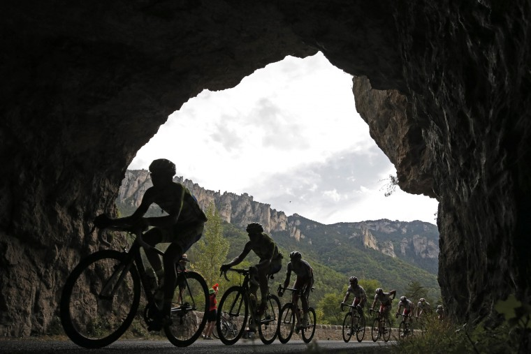 The pack passes through a tunnel in Tarn river canyon during the fourteenth stage of the Tour de France cycling race over 178.5 kilometers (110.9 miles) with start in Rodez and finish in Mende, France, Saturday, July 18, 2015. (Laurent Cipriani/Associated Press)