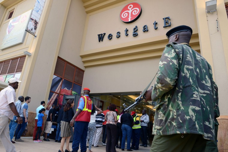 A Kenyan police officer patrols at the entrance of the Westgate shopping mall, after it reopened on July 18, 2015 in Nairobi. Kenya's Westgate shopping mall reopened for business on July 18, almost two years after Somali Islamists stormed in and massacred 67 shoppers and staff in four days of carnage. (Simon Maina/AFP-Getty Images)