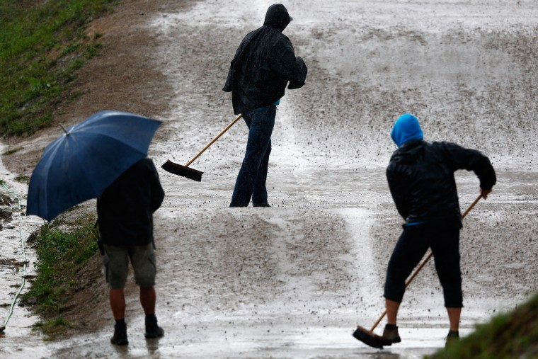 Staff clean the track from water between races during day 5 of the UCI BMX World Championships at on July 25, 2015 in Zolder, Belgium. (Dean Mouhtaropoulos/Getty Images)