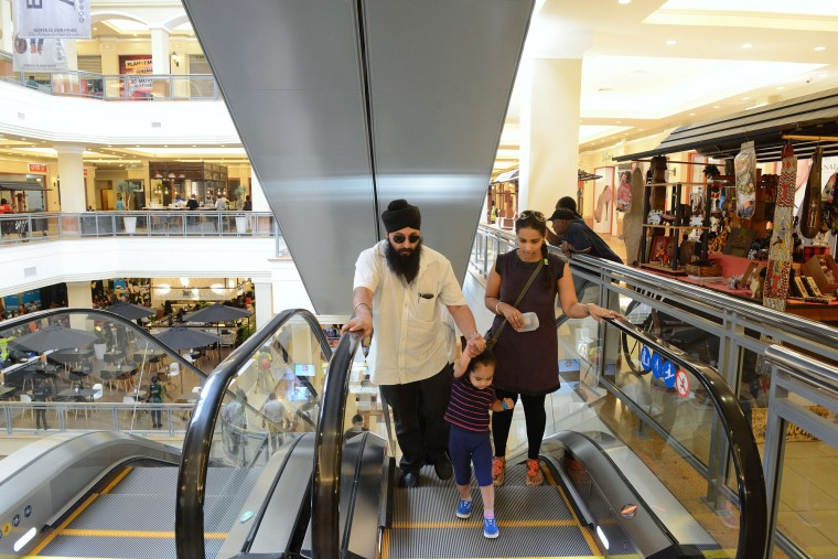 Customers are pictured in the Westgate shopping mall after it reopened on July 18, 2015 in Nairobi. Kenya's Westgate shopping mall reopened for business on July 18, almost two years after Somali Islamists stormed in and massacred 67 shoppers and staff in four days of carnage. (Simon Maina/AFP-Getty Images)
