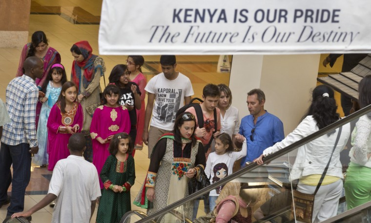 Shoppers return to the reopened Westgate Shopping Mall, nearly two years after a terrorist attack there left at least 67 people dead, in the capital Nairobi, Kenya Saturday, July 18, 2015. Hundreds of shoppers thronged through the reopened mall Saturday, following two years of repairs after security forces battled four gunmen from Somalia's al-Qaida-linked al-Shabab militant group there in September 2013. (Ben Curtis/Associated Press)