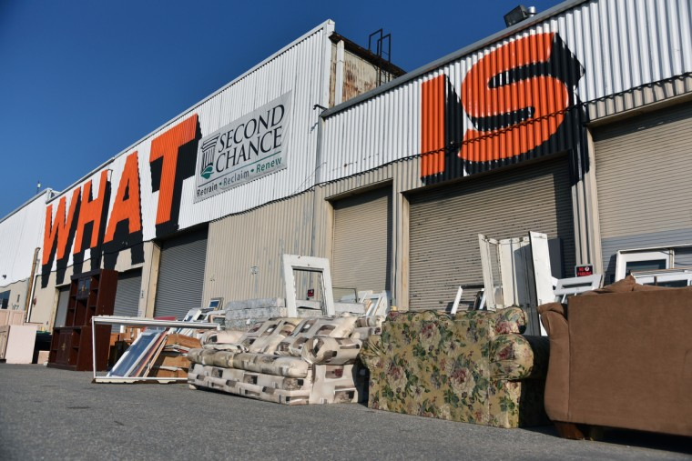 """What Is and What Can Be"" is written in large letters on the exterior of Second Chance, Inc.  The nonprofit corporation sells reclaimed building materials. The sales funds job training and employment of Baltimore City residents. (Kim Hairston/Baltimore Sun)"