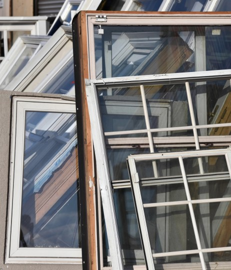 Free window frames are stacked outside Second Chance, Inc., which is a nonprofit corporation that sells reclaimed building materials.  (Kim Hairston/Baltimore Sun)