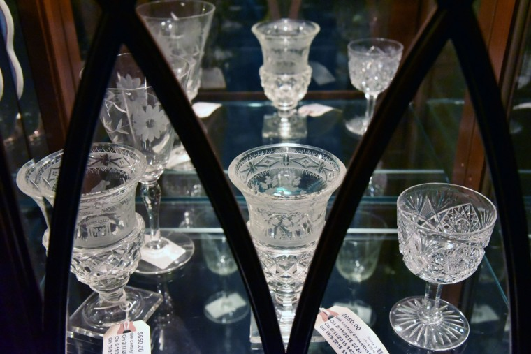 19th Century etched/cut goblets placed inside a china cabinet are for sale at Second Chance, Inc. (Kim Hairston/Baltimore Sun)
