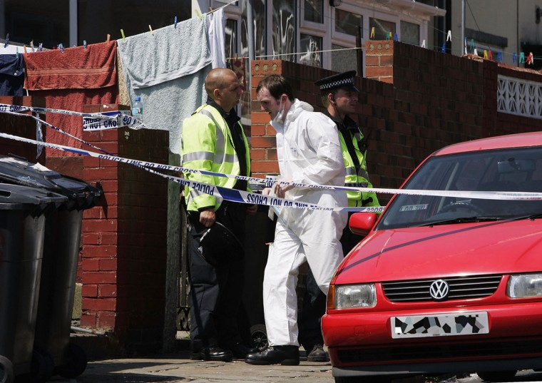Police officers are seen outside of a house as a search is made of properties suspected of being linked to terrorist activity in connection with the 7/7 bomb attack on the London transport network. (Photo by Matthew Roberts/Getty Images)