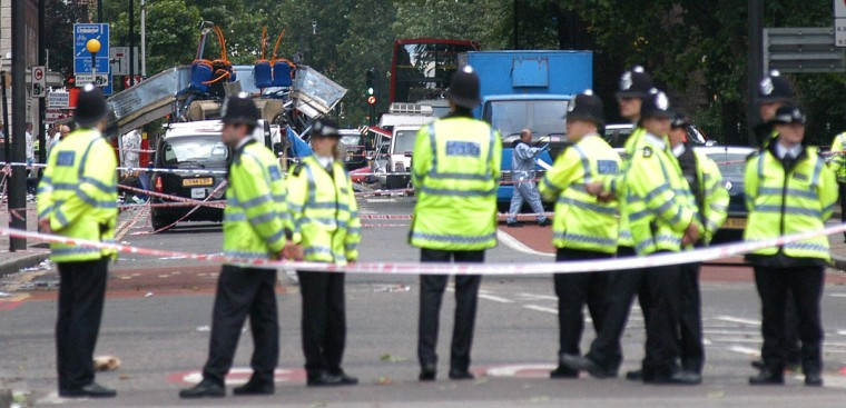 Police block access to a double-deck bus that was destroyed after a terrorist bomb exploded on it near Tavistock Square in London on July 7, 2005. (EVA-LOTTA JANSSON/AFP/Getty Images)