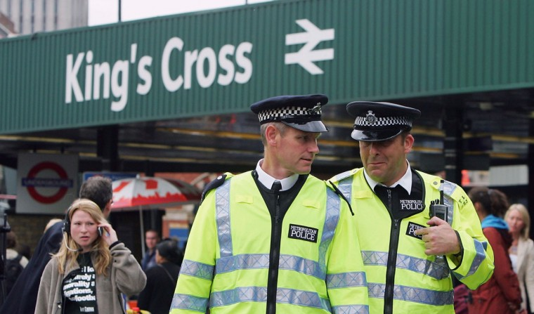 British police officers patrol outside of King's Cross Station on July 8, 2005 in London, England. More than 50 people were killed and 700 injured during a series of explosions in the morning rush hour the previous day. (Photo by Scott Barbour/Getty Images)