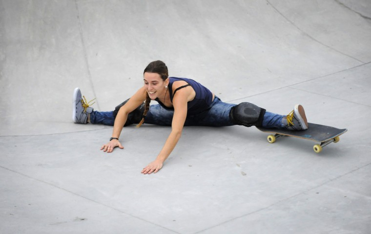 Rochelle Ward of Baltimore does a split after sliding down the bowl wall at the Skatepark of Baltimore in Hampden. (Lloyd Fox/Baltimore Sun)