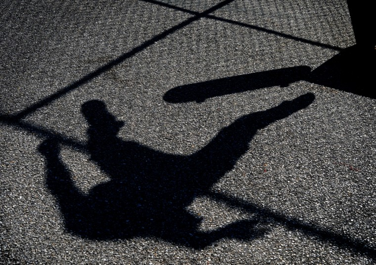 The shadow of Chris Dash of Baltimore is shown on the asphalt surface of Skatepark of Baltimore in Hampden.     (Lloyd Fox/Baltimore Sun)
