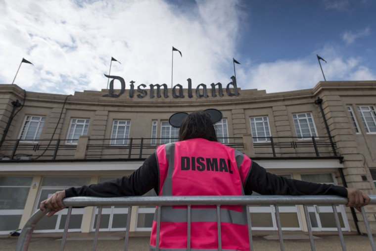 A steward is seen outside Bansky's 'Dismaland' exhibition, which opens tomorrow, at a derelict seafront lido on August 20, 2015 in Weston-Super-Mare, England. The show is Banskys first in the UK since the Banksy v Bristol Museum show in 2009 and will be open for 6 weeks at the Topicana site.  (Matthew Horwood/Getty Images)