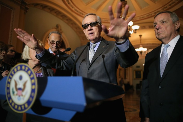 Senate Minority Leader Harry Reid (D-NV) (C) talks with reporters with Sen. Charles Schumer (D-NY) (L) and Sen. Richard Durbin (D-IL) (R) after the weekly Democratic policy luncheon at the U.S. Capitol August 4, 2015 in Washington, DC. Reid said there would be enough support to move a cybersecurity bill forward if Democrats were able to offer relevant amendments. (Photo by Chip Somodevilla/Getty Images)