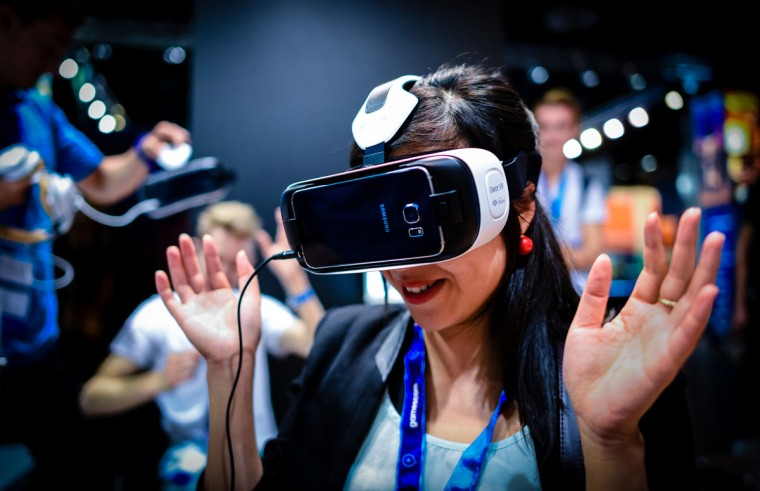 People play video games at the Gamescom 2015 gaming trade fair during the media day on August 5, 2015 in Cologne, Germany. Gamescom is the world's largest digital gaming trade fair and will be open to the public from August 6-9. (Photo by Sascha Schuermann/Getty Images)
