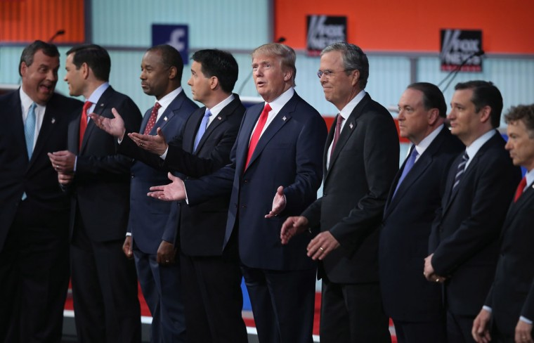 Republican presidential candidates (L-R) New Jersey Gov. Chris Christie, Sen. Marco Rubio (R-FL), Ben Carson, Wisconsin Gov. Scott Walker, Donald Trump, Jeb Bush, Mike Huckabee, Sen. Ted Cruz (R-TX) and Sen. Rand Paul (R-KY) take the stage for the first prime-time presidential debate hosted by FOX News and Facebook at the Quicken Loans Arena August 6, 2015 in Cleveland, Ohio. The top-ten GOP candidates were selected to participate in the debate based on their rank in an average of the five most recent national political polls. (Photo by Scott Olson/Getty Images)