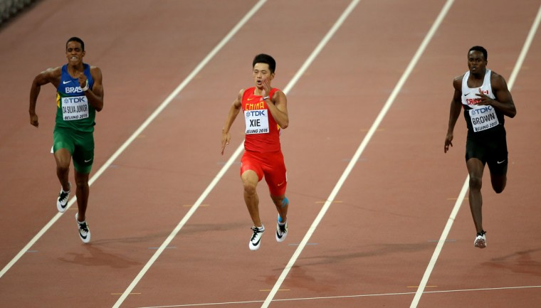 Aldemir Da Silva Junior of Brazil, Zhenye Xie of China and Aaron Brown of Canada compete in the Men's 200 meters heats during day four of the 15th IAAF World Athletics Championships Beijing 2015 at Beijing National Stadium on August 25, 2015 in Beijing, China. (Photo by Lintao Zhang/Getty Images for IAAF)